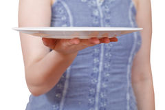 Woman holds empty white plate on hand Stock Images