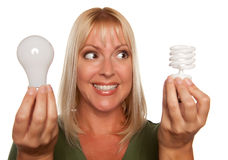 Woman Holds Energy Saving and Regular Light Bulbs Stock Photos