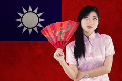 Woman holds a fan with flag of Taiwan Stock Image