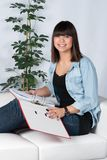 Woman holds a file Stock Photos