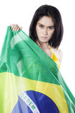 Woman holds flag of Brazil in the studio Stock Photos