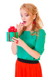 Woman holds a gift box Stock Image