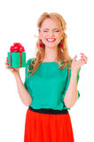 Woman holds a gift box Royalty Free Stock Photos