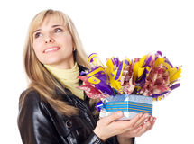 Woman holds gift in her hands Stock Image