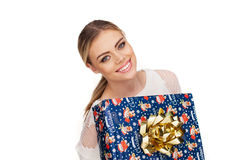 Woman holds a gift wrapped in christmas paper Stock Photo