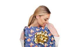Woman holds a gift wrapped in christmas paper Royalty Free Stock Image
