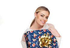 Woman holds a gift wrapped in christmas paper Royalty Free Stock Images