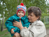 The woman holds the girl. On hands and smiles stock photography