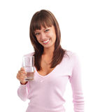 Woman holds a glass of pure water royalty free stock photography