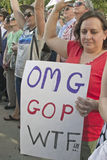 Woman Holds a GOP Protest Sign at a Moral Monday Rally in Ashevi Stock Photography