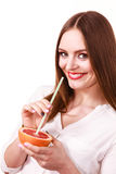 Woman holds grapefruit drinking juice from fruit Stock Photography
