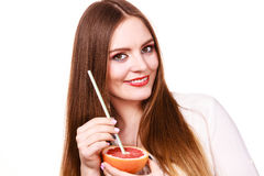Woman holds grapefruit drinking juice from fruit Stock Image