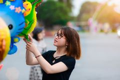 Woman Holds Green Inflatable Toy Outdoors Royalty Free Stock Image