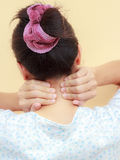 Woman holds a hand on neck  pain Royalty Free Stock Photos