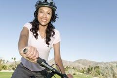 Woman Holds Handlebars Of Mountain Bike Stock Photography