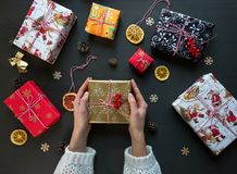 Woman holds a handmade gift for New Year and Christmas for her family and friends. royalty free stock image