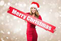 Woman holds hands: Board on Merry Christmas  subtitle Royalty Free Stock Photos