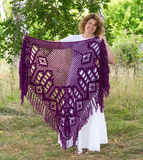 Woman holds in hands knitted shawl Royalty Free Stock Photography