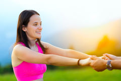 Woman holds hands with a man Stock Images