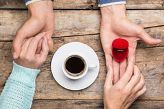 Woman holds hands of man and takes his present for engagement Stock Images