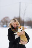 Woman holds on hands a puppy of the Welsh Corgi Stock Images