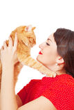 Woman holds in hands red cat Royalty Free Stock Images