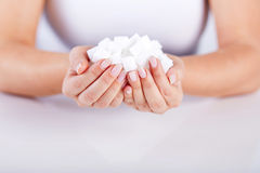 Woman holds in hands of sugar cubes. Female hands holds in hands of sugar cubes Stock Photography