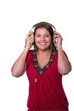 Woman holds headphones to her ears. Royalty Free Stock Image