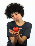 Woman holds heart in her hands Stock Photos