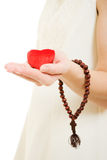 Woman holds the heart and the rosary in his hand Stock Photos