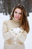 Woman holds a heart of snow Stock Images