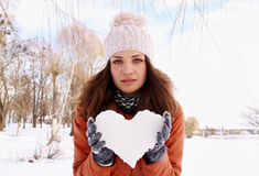 Woman holds Heart of Snow Stock Image