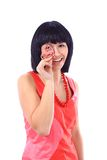 woman holds a heart symbol to her face Royalty Free Stock Image