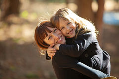 A woman holds her daughter in her arms Stock Photo