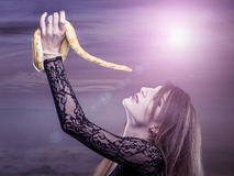Woman holds in her hand the snake Royalty Free Stock Photos
