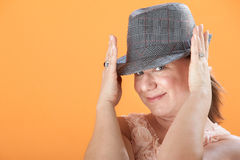 Woman Holds Her Hat Stock Photography