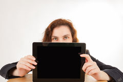 A woman holds her tablet computer in the camera Royalty Free Stock Photos