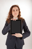 A woman holds her tablet computer in the camera Stock Image