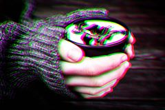 Woman holds hot cup of coffee mocha with white foam and chocolate, warming your hands in warm knitted sweater. Anaglyph, glitch. Shifted effect stock photos