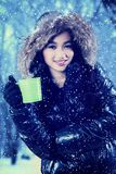 Woman holds hot tea at winter park Stock Photography