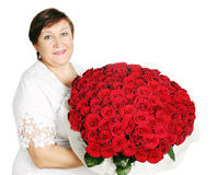 Woman holds a huge bouquet Stock Photography