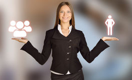 Woman holds a human icons and commands people Royalty Free Stock Image