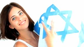 A woman holds Israel national flag stock video