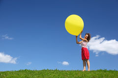 Woman holds large ball in hands on wind Royalty Free Stock Images