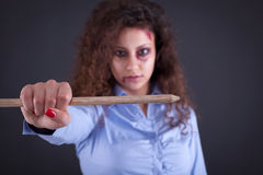 A woman holds a large pen in the name of free media and journali. War against terrorism, the concept of freedom of speech and media Stock Image