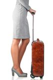 Woman holds leather suitcase Stock Image