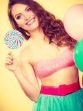 Woman holds lollipop candy and balloons Stock Image