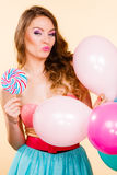 Woman holds lollipop candy and balloons Royalty Free Stock Image