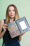 Woman holds makeup professional colorful palette Royalty Free Stock Photo