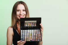Woman holds makeup professional colorful palette Stock Photo